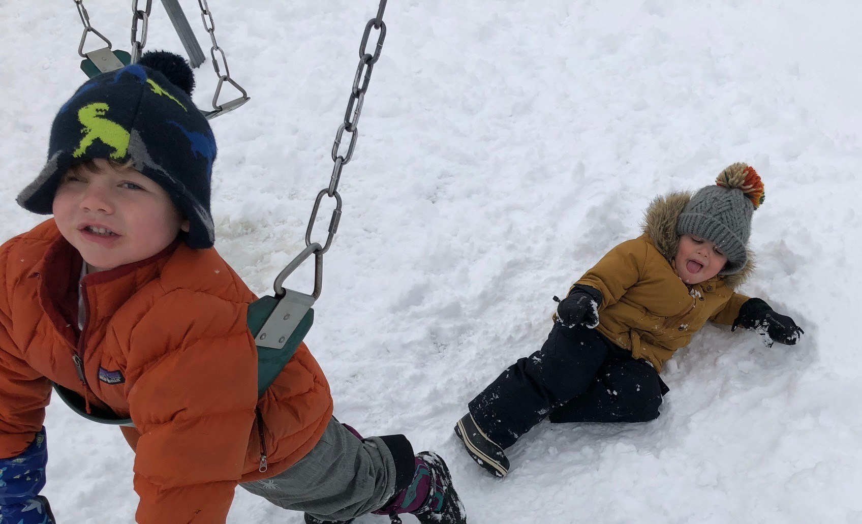 Boys_playing_roughly_on_swing_during_wintertime