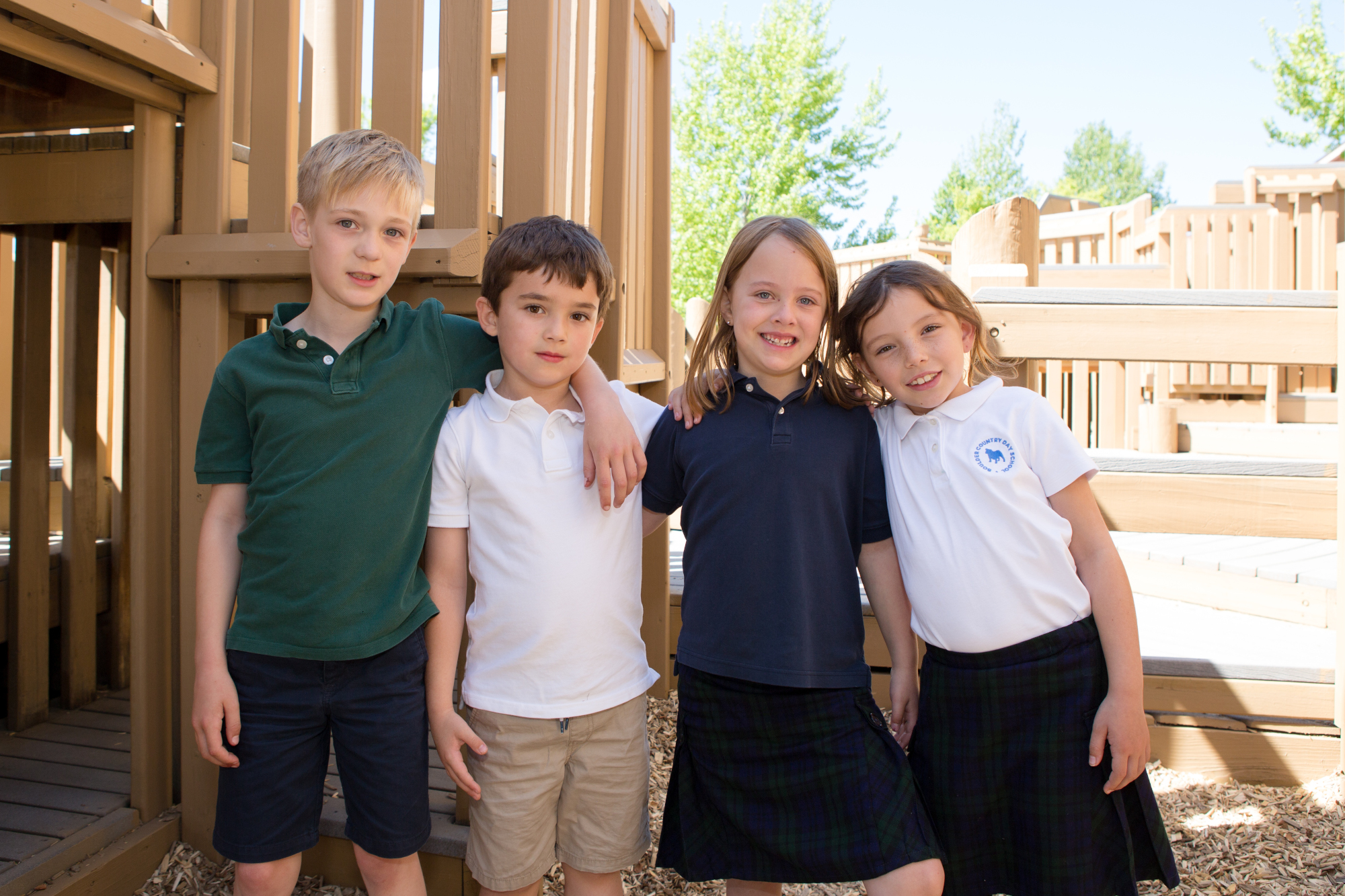 4 Elementary students together on a playground